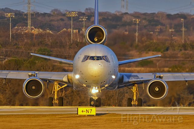 Boeing MD-11 (N609FE) - Turning onto 22 for departure just before sunset.