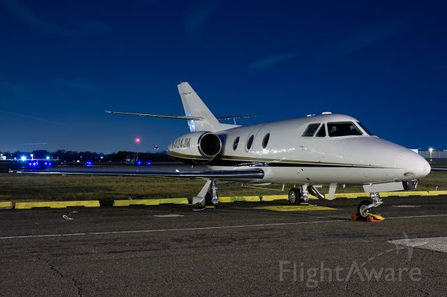 Dassault Falcon 10 (N404JW) - Sitting quiet for the evening.