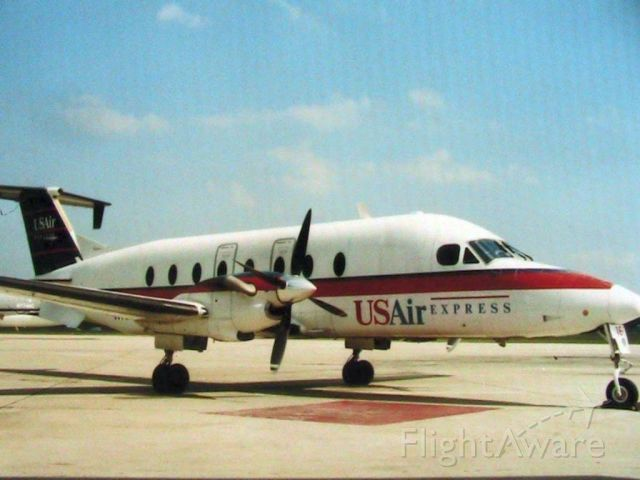 Beechcraft 1900 (N163YV) - scanned from photo