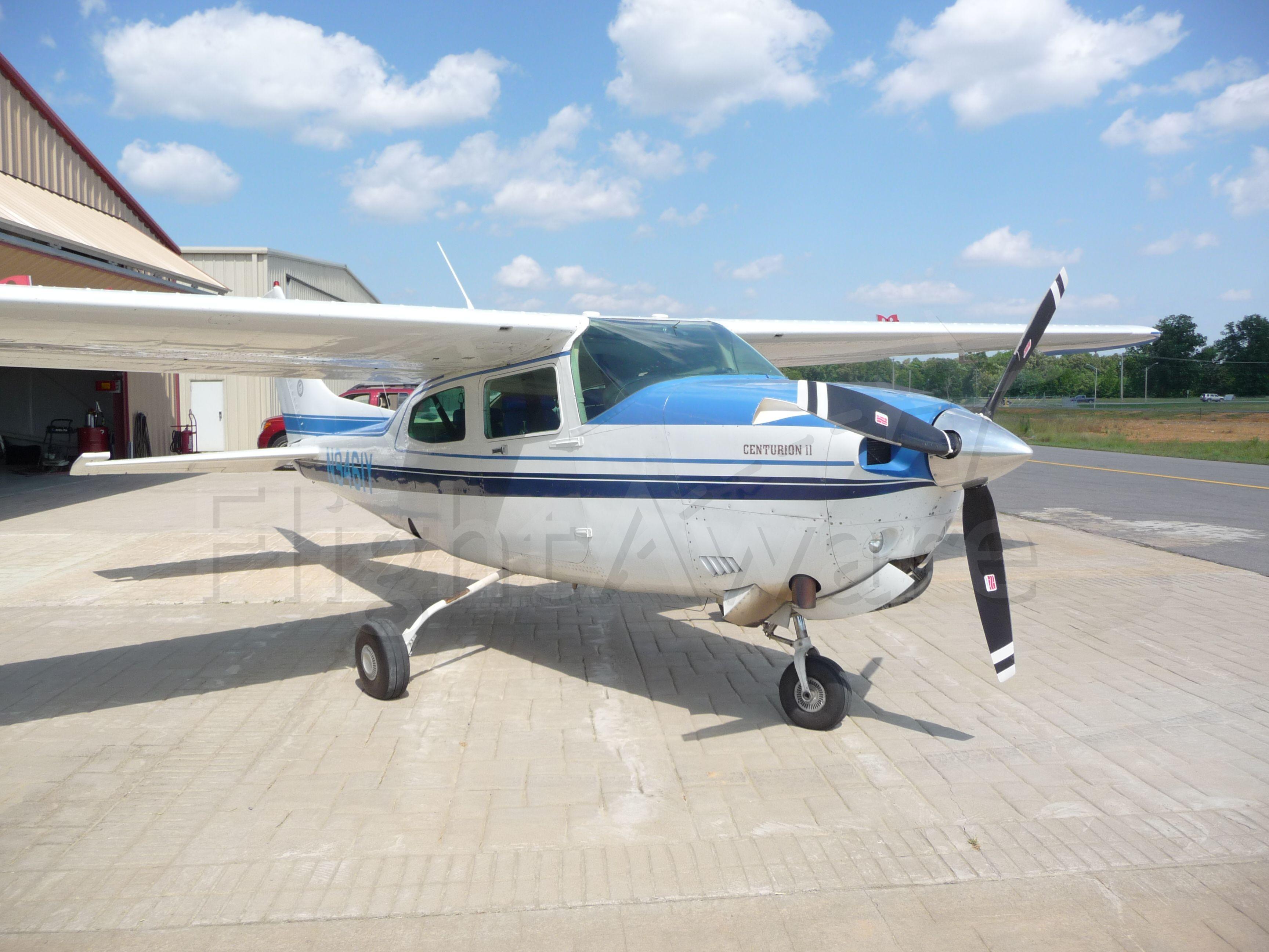 Cessna Centurion (N9461Y) - 1981 T210 Parked at the hanger at KSRC.