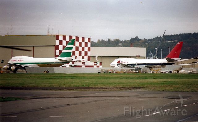 Boeing 747-400 (N662US) - KBFI- Brand new 747 400 series at Boeing Field Nov 1988. On the left is VR-HOO as cn 23814/705 and NWA N662US 23720/708. There were 2 other 747 400 off to the left and were probably the 1st 2 747 400 s built. VR-HOO was re-reg after July 9-1997 after China took over BCC of Hong Kong - re reg to B-HOO. N662US is now absorbed into Delta Airlines. Internet records indicate B-HOO is scrapped.