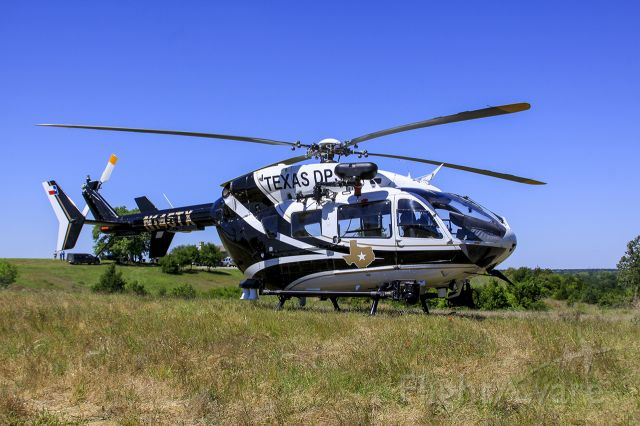 N145TX — - Texas DPS EC145 parked in the grass during a SAR exercise