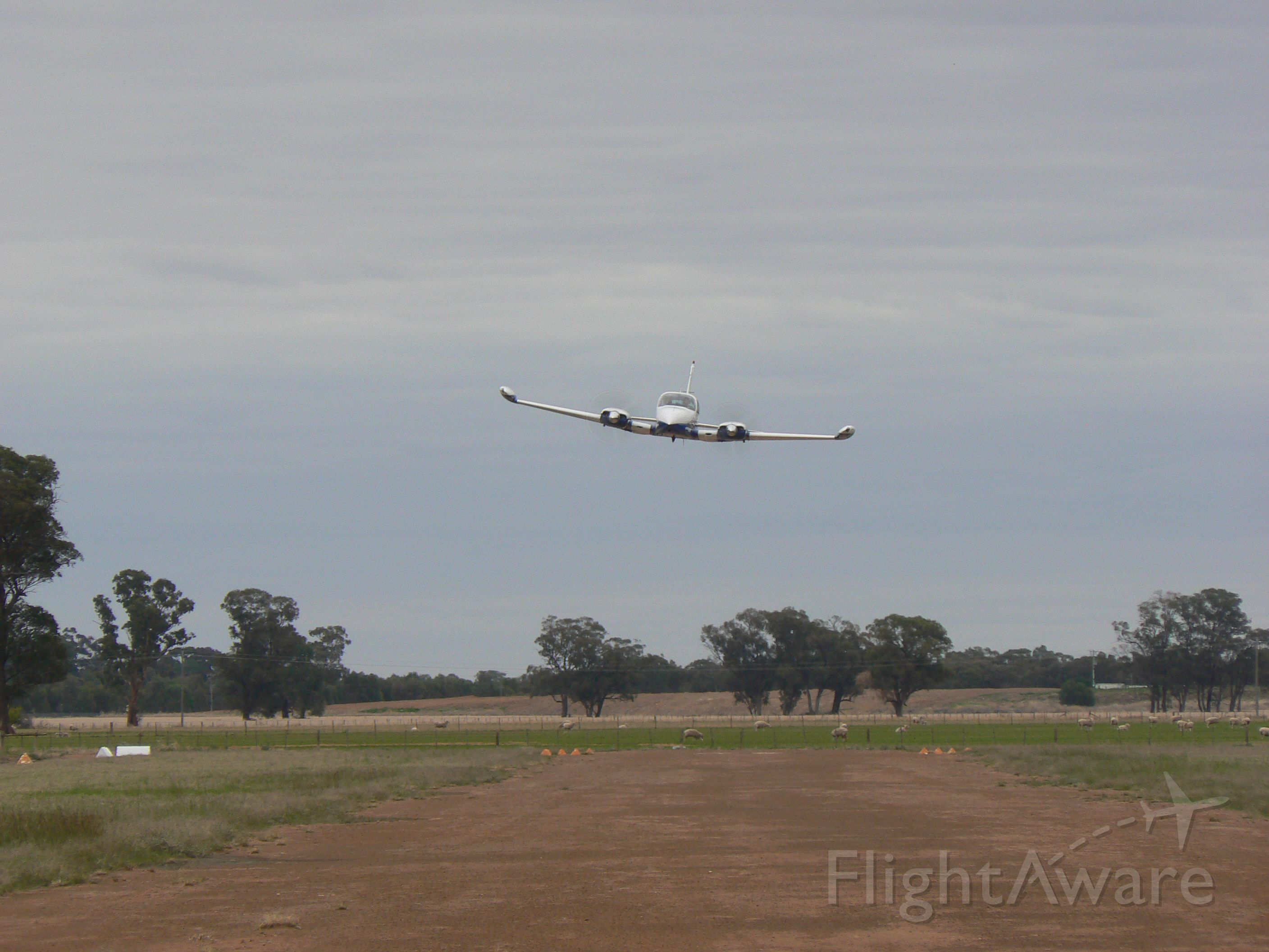 Cessna 310 (VH-JOI) - Low pass on RWY 05