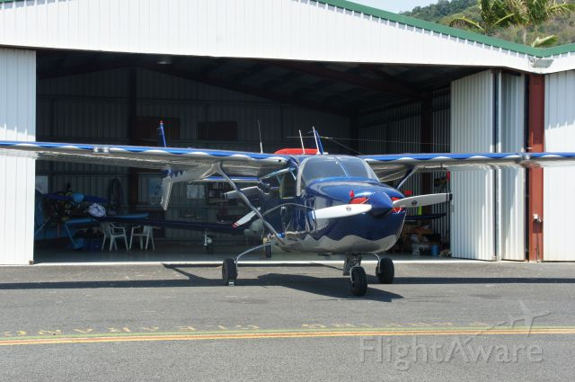 Cessna Super Skymaster (VH-OIQ) - Outside Hangar 2, Southern hangars, Cairns. VH-PIQ in background.