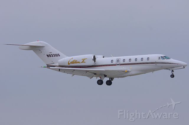 Cessna Citation X (N933QS) - ILS 25R.