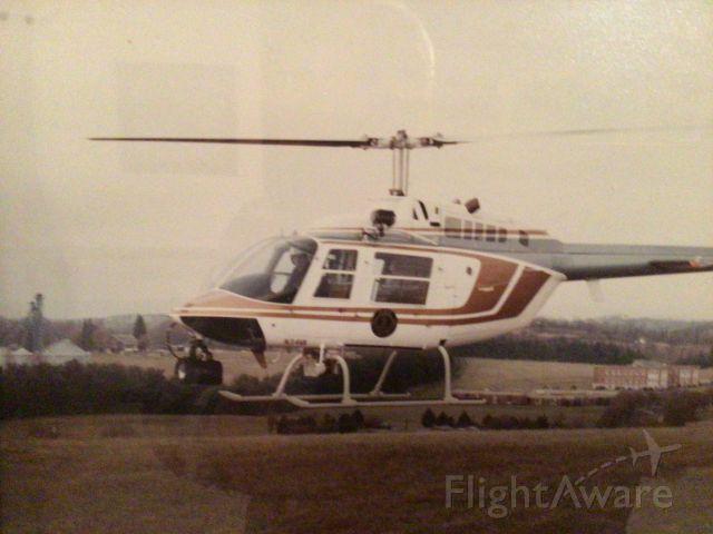 Bell 407 (N34VA) - Photo was taken many year ago. Trooper/Pilot Allan Burke hovering near Stanton Va