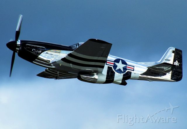 """— — - Famous """"QuickSilver"""" P-51 Mustang over Yeager Airport."""