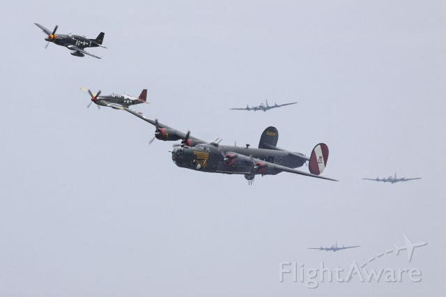 """Consolidated B-24 Liberator (N224J) - """"Time Machine"""" - as through the mists of history, the Collings Foundations B-24J """"Witchcraft"""", escorted by P-51s and followed by B-17s, as seen at the 2010 Thunder Over michigan airshow."""