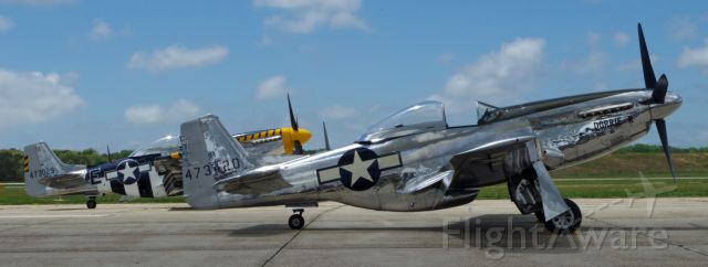 North American P-51 Mustang (NL151AM) - MILLVILLE, NEW JERSEY, USA-MAY 09, 2015: Seen on the tarmac at the airshow were two North American P-51 Mustangs.
