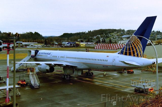 """Boeing 757-200 (N17139) - KRNT - Feb 2000, back before no one ever thought of Continental would be taken over by United, this brand new 757-200 in the final stages for delivery. CN: 30352 LN:911 on the ramp at Renton, WA - I never got to smell that """"new aircraft"""" smell, but I bet it is great. I took this from the Chamber of Commerce parking lot."""