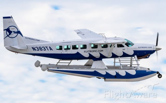 Cessna Caravan (N383TA) - FO justin giving me a flyby in 3TA seaplane at GHC/MYBG