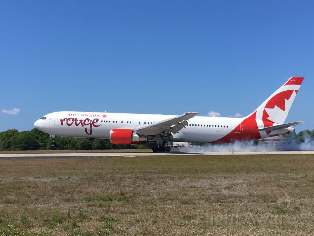 BOEING 767-300 (C-GEOU) - Air Canada Rouge arriving in TPA.
