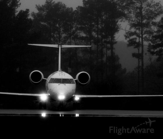Canadair Regional Jet CRJ-200 (N882AS) - Rainy-day at Fayetteville.