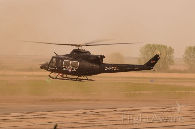 Bell 412 (C-FYZL) - RCAF Bell 412 kicking up some dust on departure fromYQV