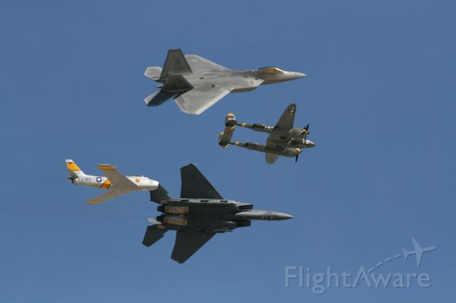 — — - Heritage Flight, F22/F15 break at March Airfest 2010