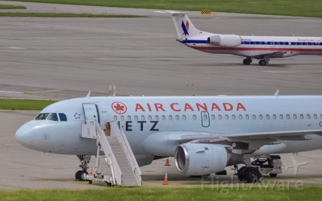 Airbus A319 (C-GBIK) - Air Canada Jetz sitting at the FBO signature ramp. June 2018