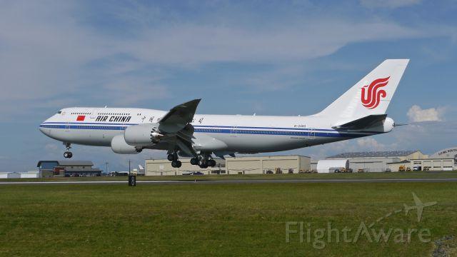 BOEING 747-8 (B-2480) - BOE72 nears touchdown on Rwy 34L to complete its B1 flight on 5/20/15. (ln 1518 / cn 41194).