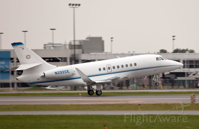 Dassault Falcon 2000 (N202CE) - The moment of lift off. Runway 10.