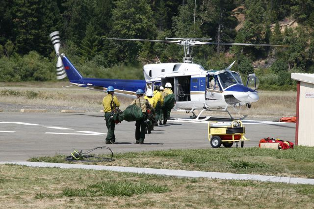 Bell VH-1 (N873HL) - Helitack crewmen load up for ferrying to a remote fire.  Airport is Forest Service owned Happy Camp, California