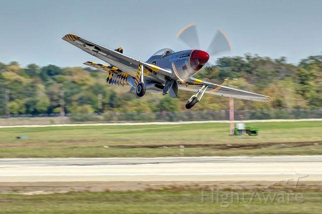 "North American P-51 Mustang (N51MV) - P-51 ""Luscious Lisa"" banks after taking off."