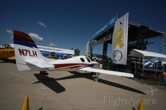 Lancair Evolution (N7LH) - To see more photos from the 2013 EAA Airventure, click here- a rel=nofollow href=http://www.facebook.com/media/set/?set=a.10153121083865078.1073741840.283142505077&type=1&l=dc84cd9463https://www.facebook.com/media/set/?set=a.10153121083865078.1073741840.283142505077&type=1&l=dc84cd9463/a
