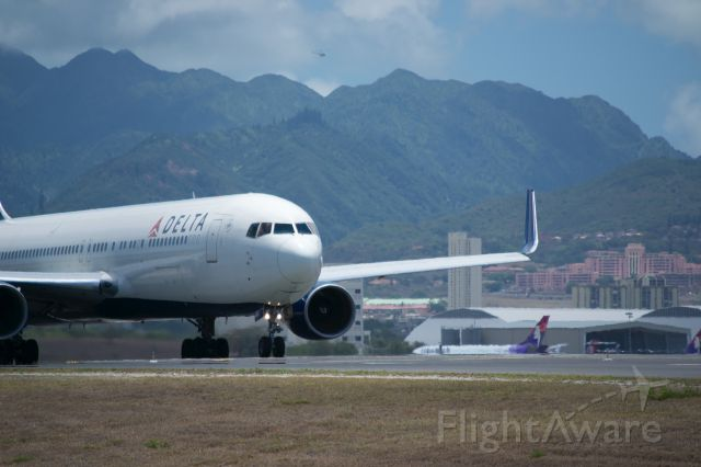 BOEING 767-300 — - Delta 767-300 with Tripler Army Hospital in the back.