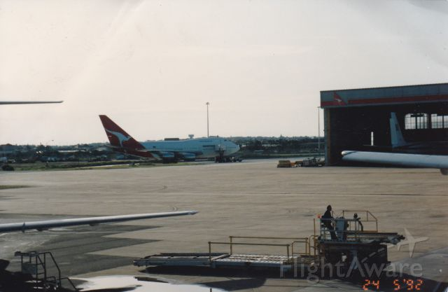 Boeing 747-200 (VH-EAB) - Th good old days here at Sydney airport the home of Qantas here we see a rare photo I had taken from the terminal 1998 of a Qantas 747SP jet awaiting next assignment Gone but not forgotten broken up 2001
