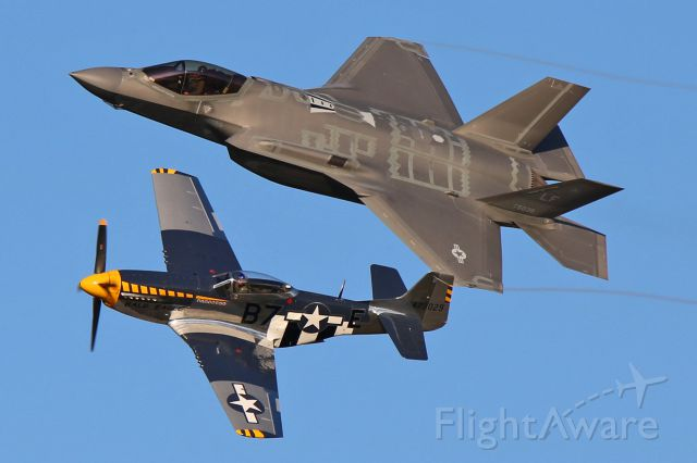 """Lockheed F-35C (11-5038) - Jim Beasley, Jr. in his P-51D Mustang """"Bald Eagle"""" (N51JB, c/n 44-73029-A) and a USAF Lockheed F-35A Lightning II (11-5038, c/n AF-49) from the ACC Demo team during the Friday evening twilight Heritage Flight performance."""