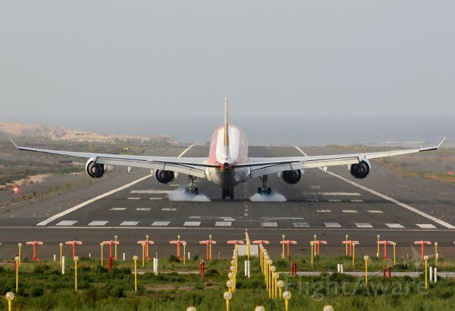Airbus A340-600 (EC-IOB) - Touchdown on the runway 03L.