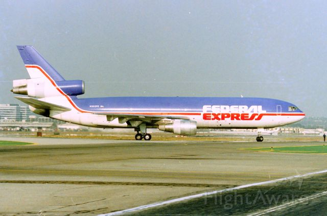 McDonnell Douglas DC-10 (N303FE) - KLAX - Federal Express dash 30 rolling off 25L at Los Angeles for the cargo ramp. Date apprx March 1990  CN:46802 LN:110