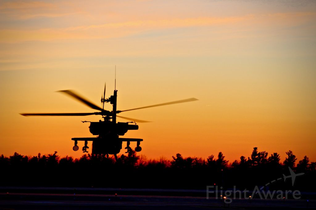 — — - An AH-64D Apache Longbow takes off into the sunset in upstate New York