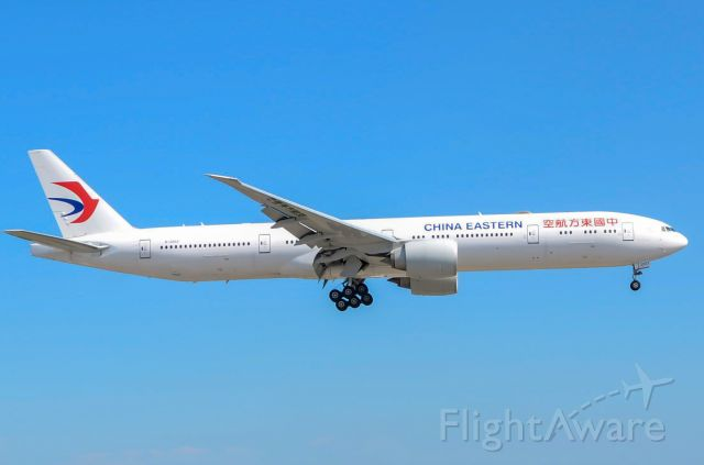 BOEING 777-300 (B-2003) - Here is a China Eastern B777-300ER on final for 23 at Toronto Pearson Airport. Date taken July 18th