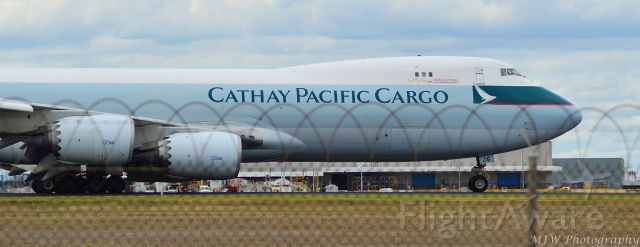 Boeing 747-200 — - Was unable to get high enough to see over the fence completely but im happy i have a photo, very rare that i get to see this girl, landed taxiing RWY32 from a stop-over at Sydney.