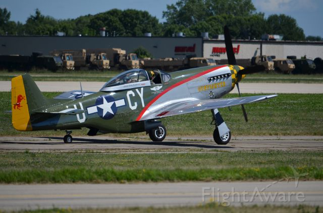 """North American P-51 Mustang — - EAA 2011 P-51D """"Gunfighter"""" taxiing."""
