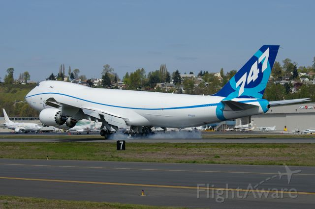 BOEING 747-8 (BOE521) - 747-8F smokes the landing after a certification test flight.