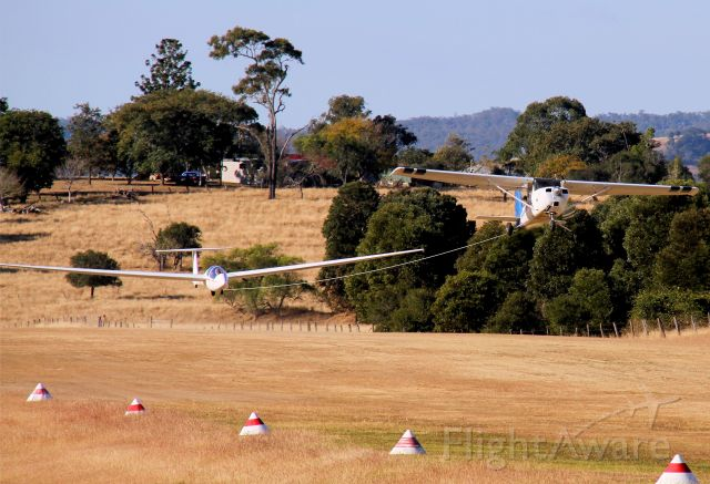 VH-BGE — - Sequence showing Cessna 150 tug tow launch at Boonah Queensland. Tug has 180hp engine.Glider is Schleicher ASK 21 of Boonah club