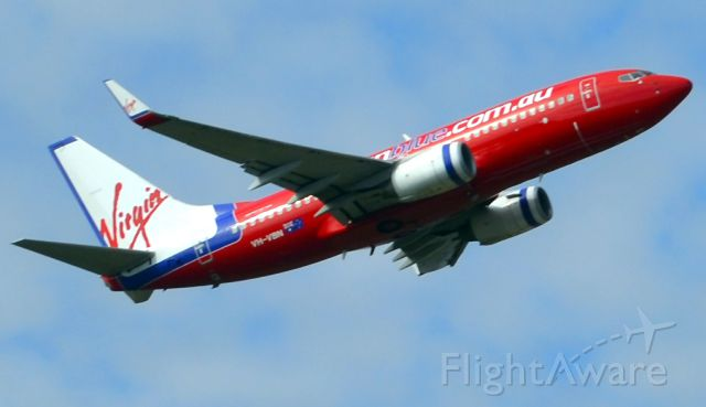 Boeing 737-700 (VH-VBN) - Departing Adelaide on a beautiful autumn Saturday bearing the now superseded bright and colourful livery. Much more attractive than the boring and dull new white livery for Virgin Australia.