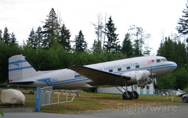 Douglas DC-3 (N877MG) - The aircraft is being worked on at Sealand in Campbell River.  Tail Number was N877MG before renovations started