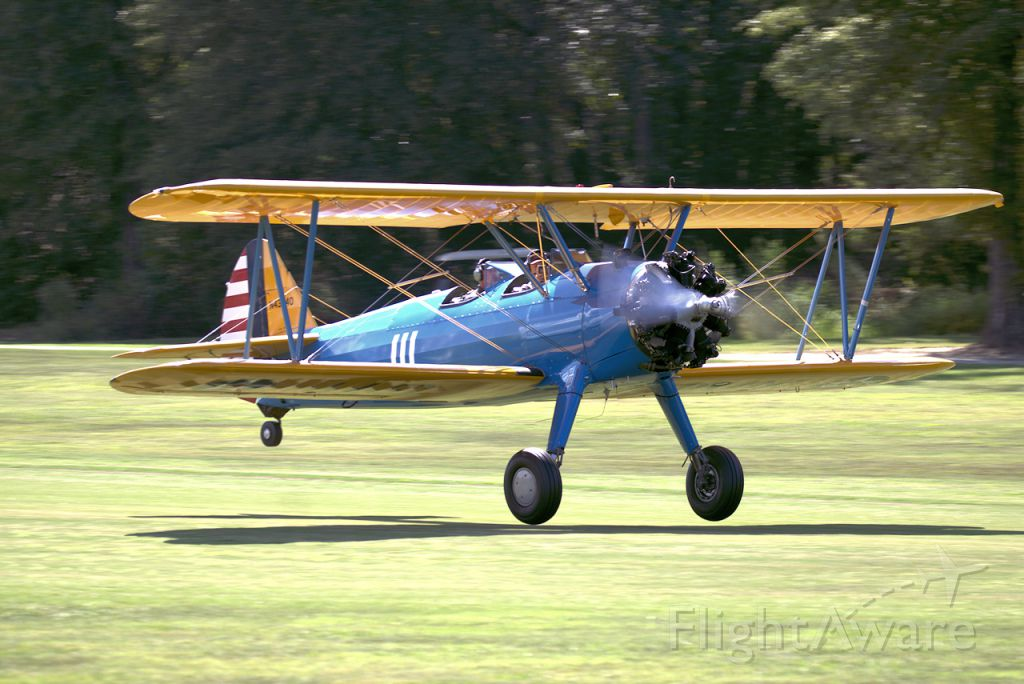 N43340 — - Flying as it was meant to be. Boeing PT-17 taking off from the grass runway at Triple Tree Aerodrome.