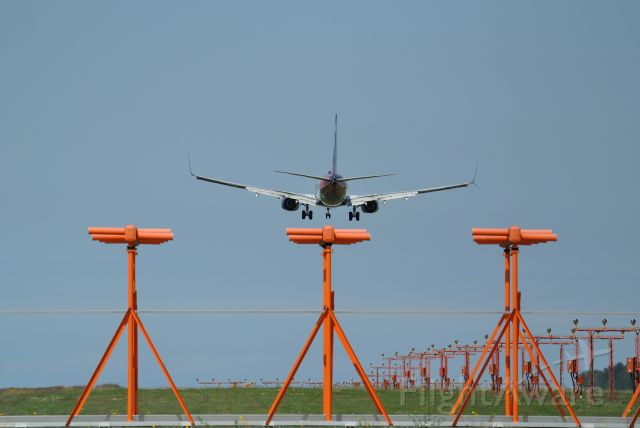 Boeing 737-800 (C-GWSZ) - Westjet 737 with Disney livery descending on 26R
