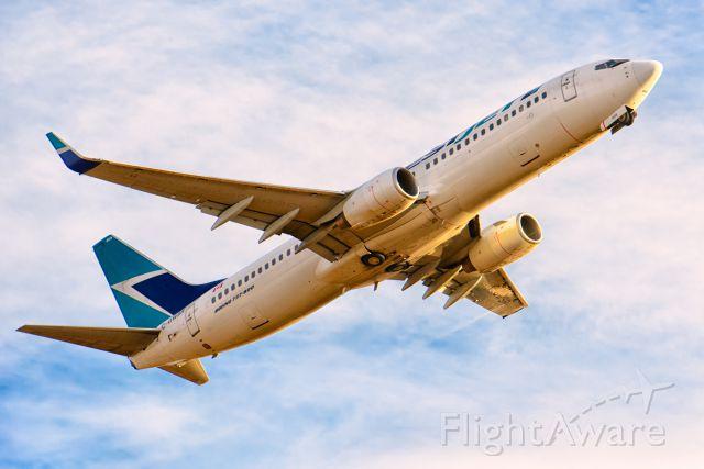 Boeing 737-800 (C-GWSR) - Taking off Runway 29 in Calgary, Alberta near sunset