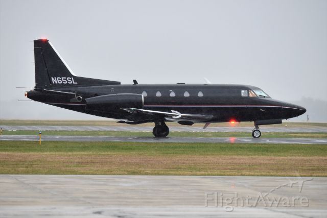 North American Sabreliner (N65SL) - In the rain, that's why the photo is grainy