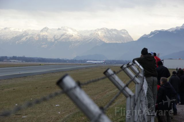 Boeing 747-400 (EI-XLI) - Thats me hanging over the fence of Salzburg, Austria ... this picture was taken by my pal Tommy P.