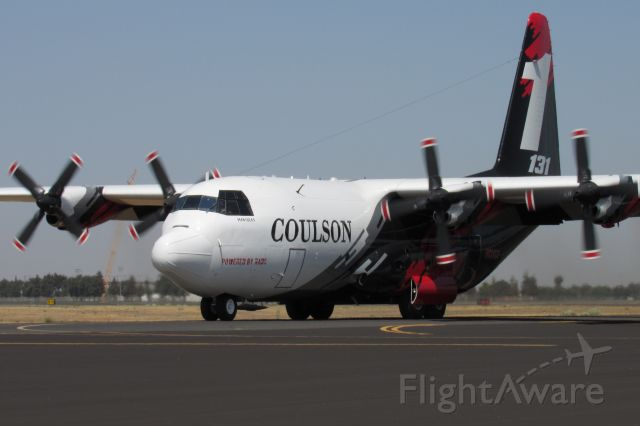 Lockheed C-130 Hercules (N131CG) - Coulson Tanker 131 taxiing to the base after a fire dispatch.