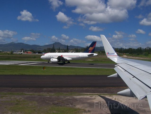 — — - TACA A320 on the infamous runway at Toncontin International in Tegucigalpa, Honduras, about to takeoff.  My Boeing 757-200w/ winglets is next in line for Miami.