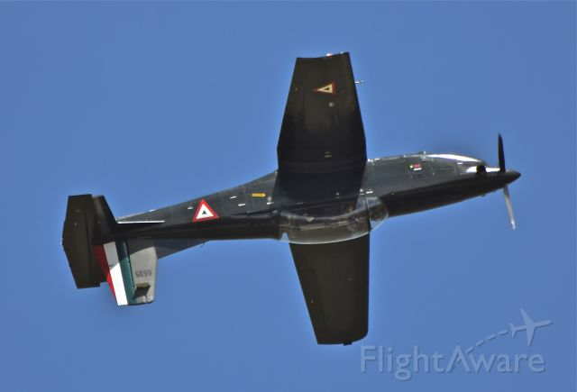 Pilatus PC-7 Astra (FAM6535) - Escuela Militar de Aviacion (EMA) or Military Aviation School, Pilatus PC-7 Turbo Training FAM 6535 displaying an inverted flight over Santa Lucia AB
