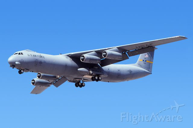 Lockheed C-141 Starlifter (67-0014) - March 1997 - C-141 (70014) on final for 21L at Nellis AFB.