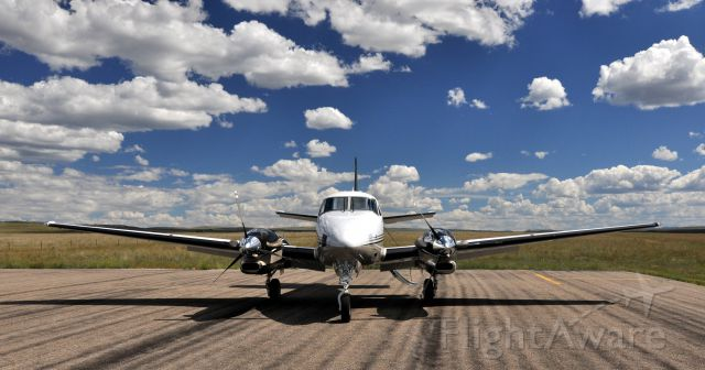 Beechcraft King Air 90 — - On the ramp at Silver West Airport.  Westcliffe, Colorado.