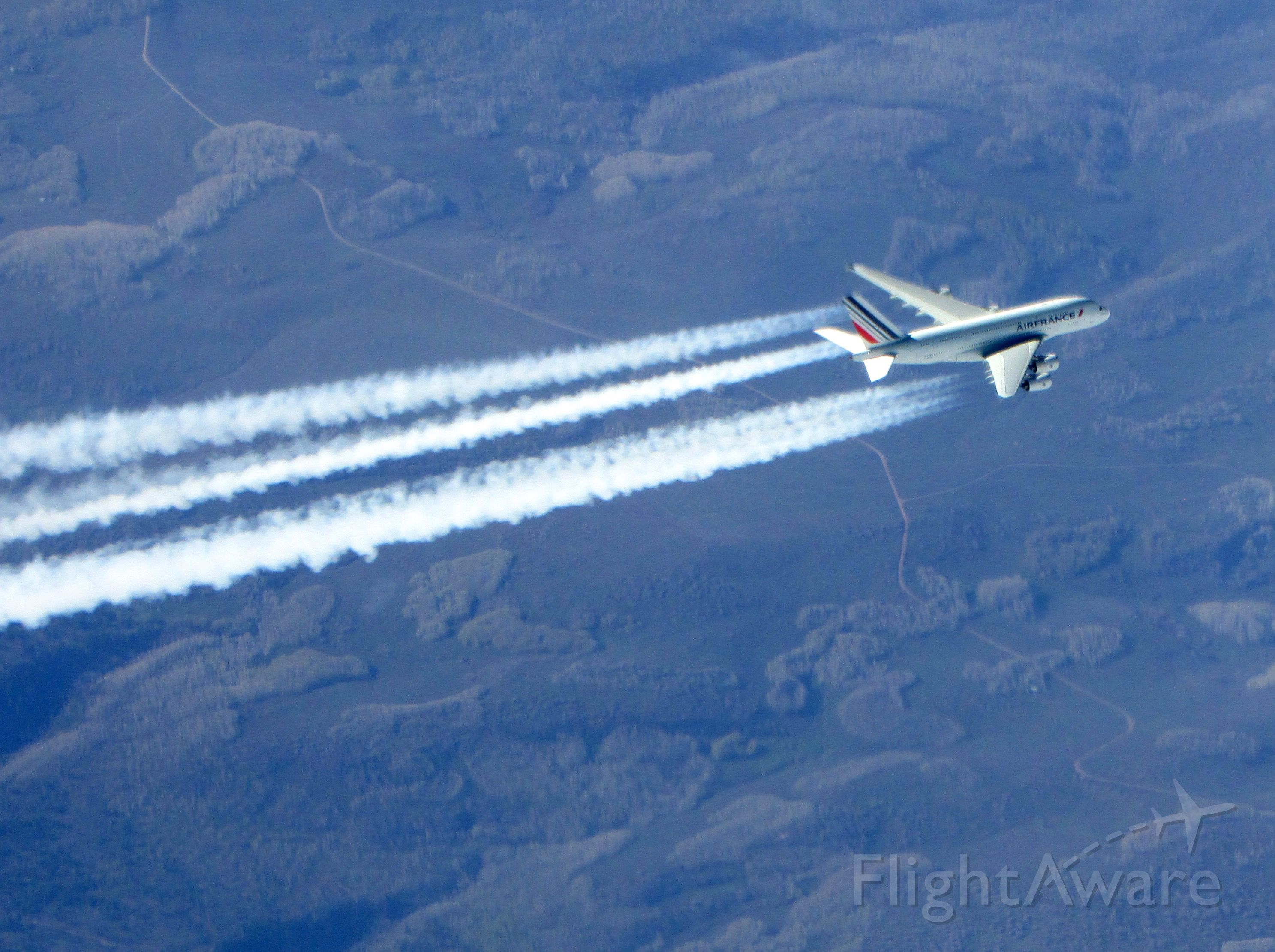 Airbus A380-800 (AFR65) - We captured this picture while overtaking this Air France A380 over Utah.  We were at FL410, they were at FL370.  AFR065, departed LAX to LFPG.