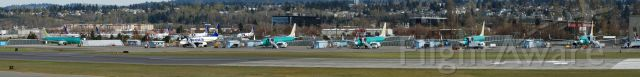 — — - Various Boeing aircraft in different stages of assembly at Boeing Field
